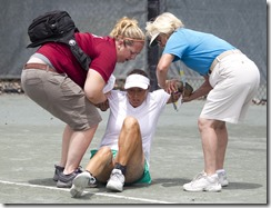 May 2, 2014; Palm Beach Gardens, FL USA Tracy Houk (USA) receives medical attention (WS50)